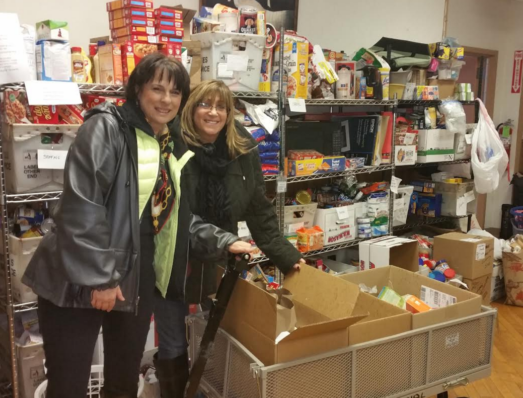 Laurie Wernick and Paula Burns drop off the last boxes of food for 2015.