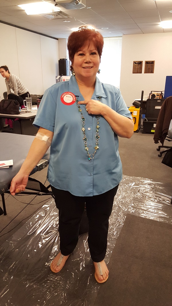 Laura, pictured here after her donation, and Jim are the coordinators of our blood drives. They do a great job of getting the word out (I do marketing here and I can learn a thing or three from them).