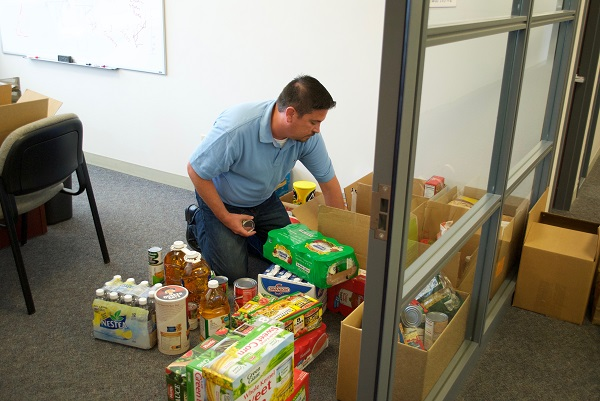 Sales Manager Paul packing up the goods collected from the sales and marketing teams.