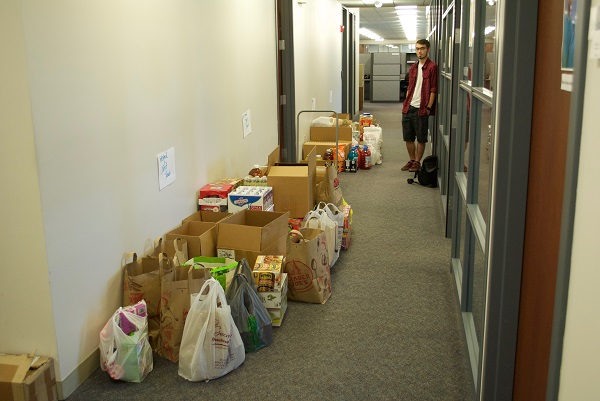 The boys are checking out their great work: our hallways are filled with food!