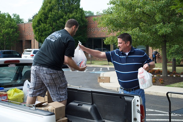 Shane and Paul pack-up the pick-ups with all the good grub.