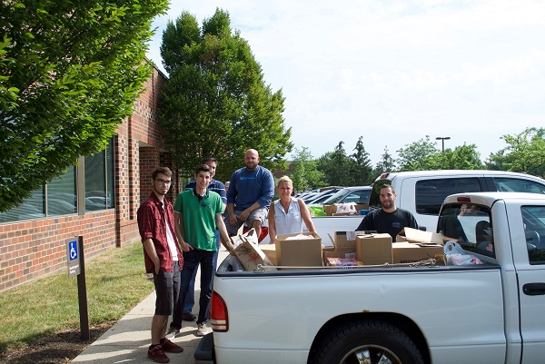 Alex, Steven, Paul, Frank, Eleanor, and Shane take a well-deserved break after loading up two trucks of food!