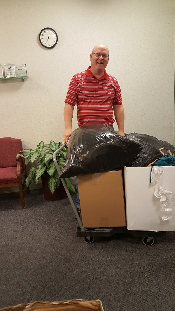 Carl is wheeling out his haul of collected goodies from SofterWare to his truck.