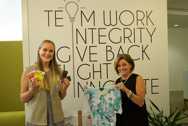 Devin and Becky showing off some of the goods collected for Dress for Success.